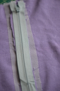 Place the zipper right side down on the seam alowances