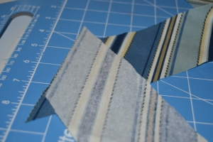 Offset your strips by the same amount as the width of your seam allowance.