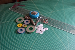Pattern cutting tools, scissors, rotary cutter, pins, pattern weights, and a ruler