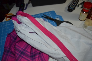 Press the tape and sew the zipper to the seam allowance only of the lining